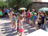 The Children performing French songs and the parents and students enjoying