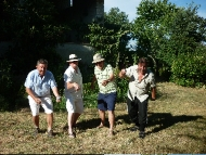Four brothers pretending to play pétanque!