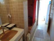 Bathroom with washbasin and shower