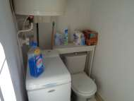 Laundry with washing machine and hot water heater