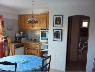 The dining room with the kitchen corner & all amenities. Two bedrooms, bathroom, separate toilet, laundry suitable for 4 people