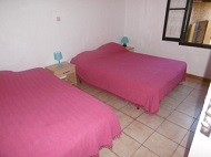 Bedroom with two double beds & fans