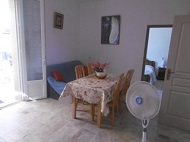 Same kitchen with dining corner and fans
