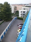 View from the balcony on the parking of cars with secure portal